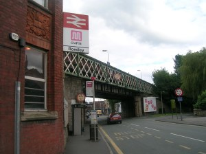 Romiley Station from http://upload.wikimedia.org/wikipedia/commons/d/dc/Romiley_railway_station_1.jpg